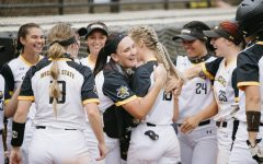 Wichita State players celebrate after a home-run during the game against UCF on May 15.