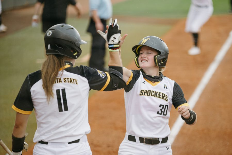 Wichita State freshman Addison Barnard high-fives Neleigh Herring during the game against Texas A&M on May 21.