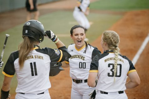 Wichita State senior Madison Perrigan celebrates with teammates during the game against Texas A&M on May 21.