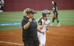 Wichita State freshman Addison Barnard celebrates with head coach Bredbenner during the game against Texas A&M on May 21.
