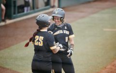 Wichita State Neleigh Herring and Sydney McKinney celebrates during the Regional Final game against OU on May 23.