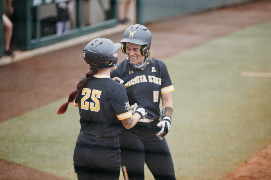 Wichita+State+Neleigh+Herring+and+Sydney+McKinney+celebrates+during+the+Regional+Final+game+against+OU+on+May+23.