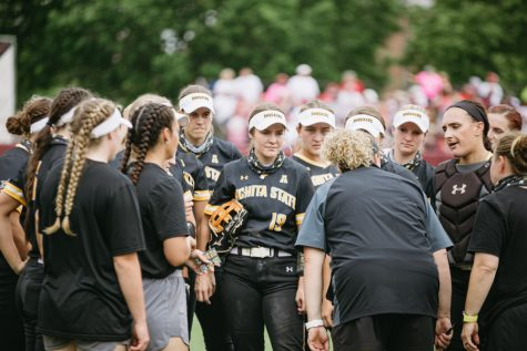 Head Coach Kristi Bredbenner talks to the team during the Regional Final game against OU on May 23.