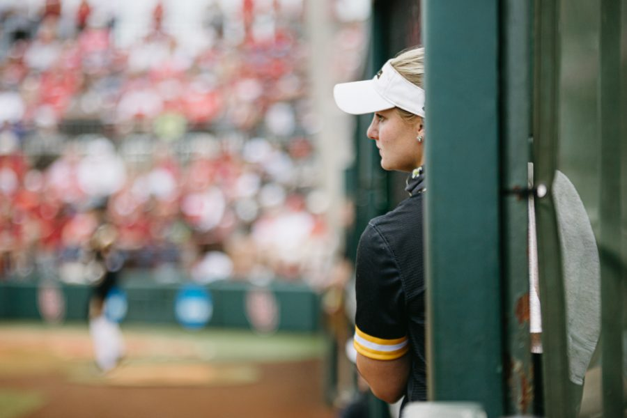 Wichita State senior Bailey Lange watches her teammates from the sideline during the Regional Final game against OU on May 23.