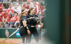Wichita State junior Neleigh Herring celebrates with her teammates after hitting a home-run during the Regional Final game against OU on May 23.