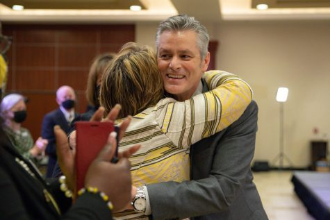 Rick Muma hugs Teri Hall, vice president of student affairs, after being named the 15th  president of Wichita State University Thursday, May 6.
