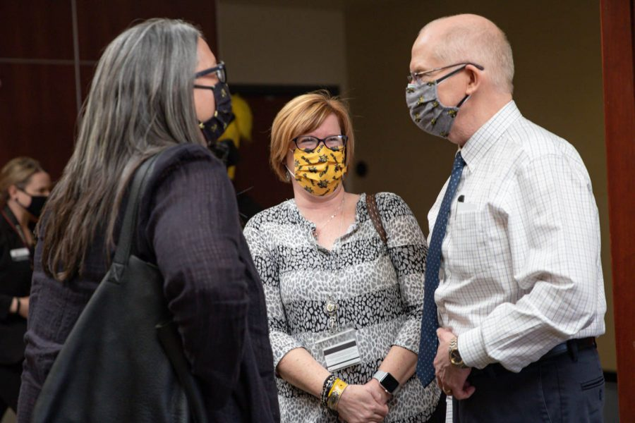 Wichita State staff and representatives converse following the announcement of the next president at Beggs Ballroom on May 6.