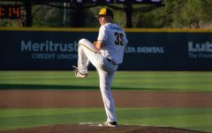 Freshman Jace Kaminska pitches during WSU's game against East Carolina on April 30 inside Eck Stadium.