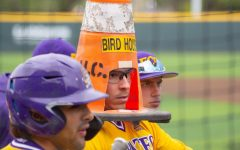 East Carolina's Thomas Francisco celebrates after hitting a home run by putting a traffic cone on top of his head.