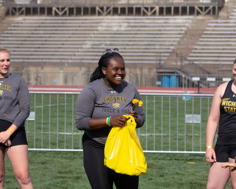 Wichita State graduate student Alex Adams smiles during Track and Field's senior ceremony at the Shocker Open inside Cessna Stadium on Friday.
