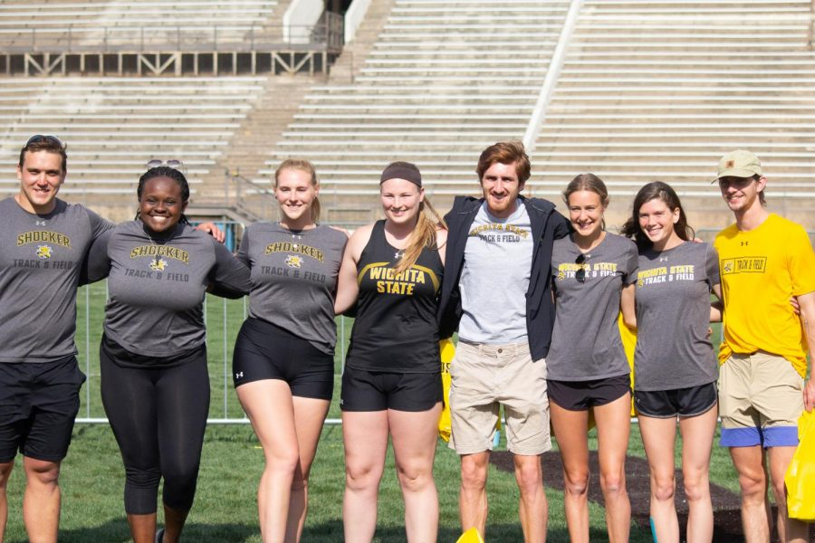 A group of Wichita State seniors gather for a picture during Track and Field's senior ceremony at the Shocker Open inside Cessna Stadium on Friday.