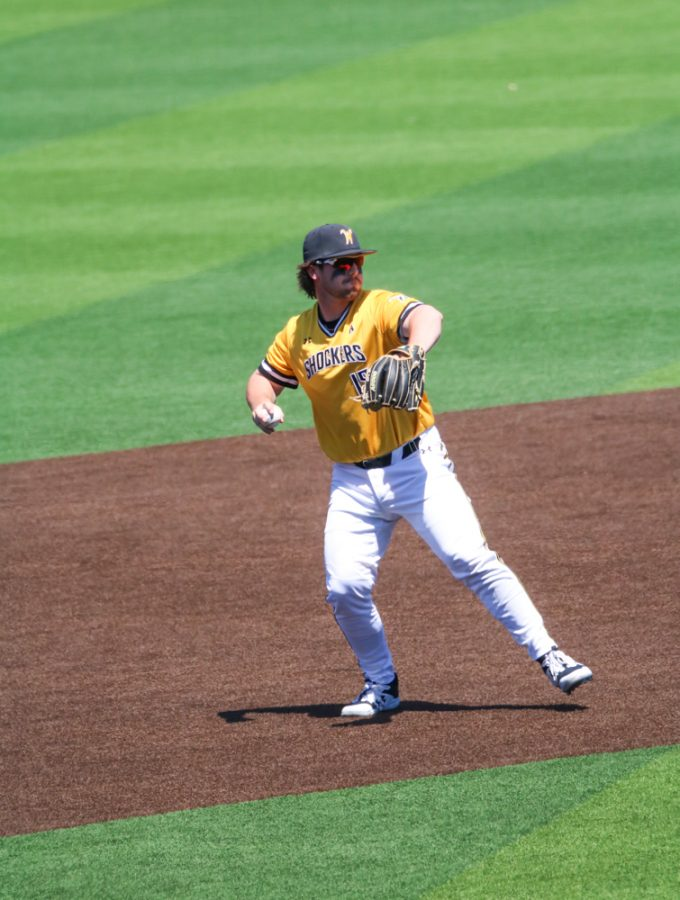 Wichita State junior, Paxton Wallace throws the ball to his fellow teammate during a game against East Carolina at Eck Stadium on April 30