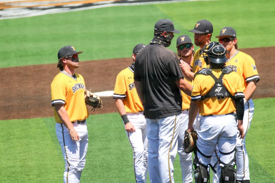 Wichita State baseball players talk to their coach during a game against East Carolina at Eck Stadium on April 30