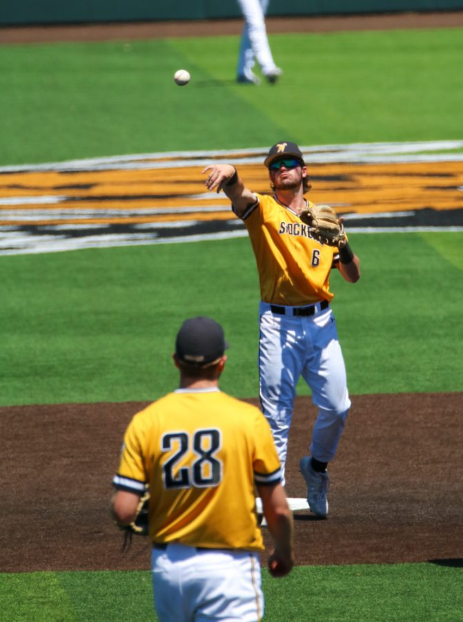 Wichita State sophomore, Jack Sigrist throws the ball to his fellow teammate during a game against East Carolina at Eck Stadium on April 30