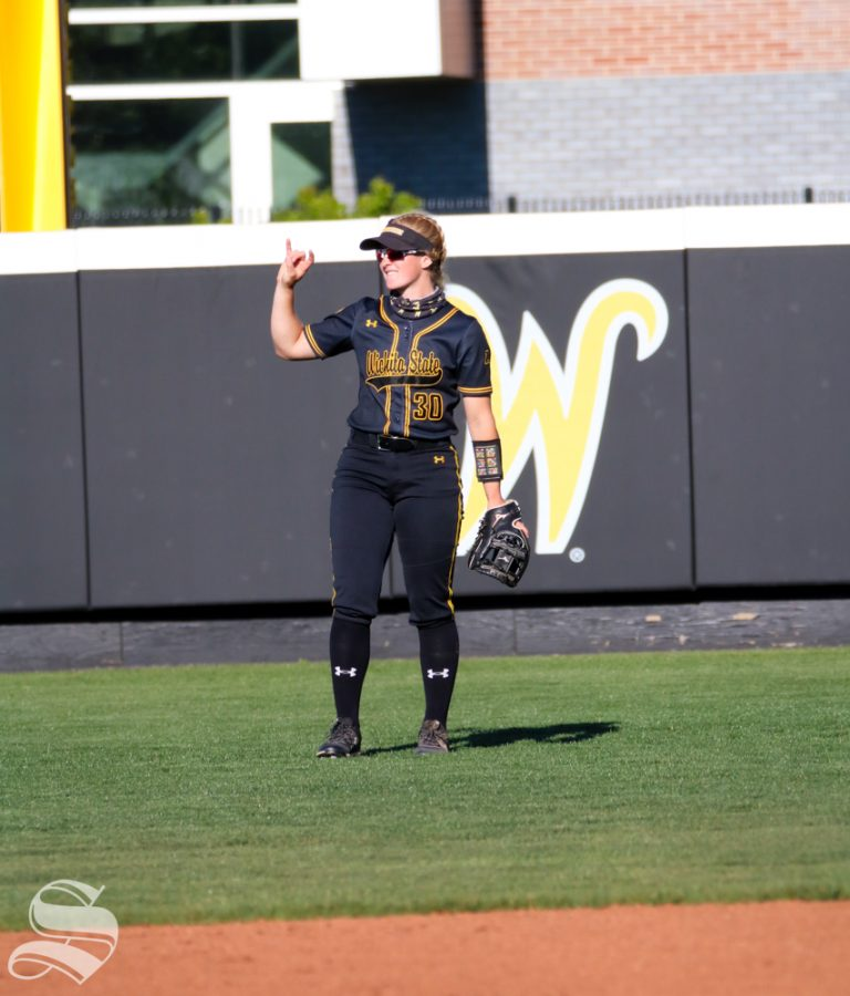 Wichita State freshman, Addison Barnard cheers on her team during a game against University of Oklahoma at Wilkins Stadium on April 4