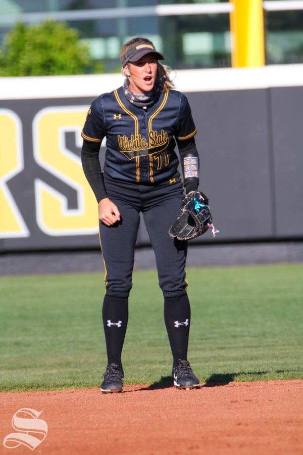 Wichita State senior, Kaylee Huecker yells at her fellow teammates during a game against University of Oklahoma at Wilkins Stadium on April 4
