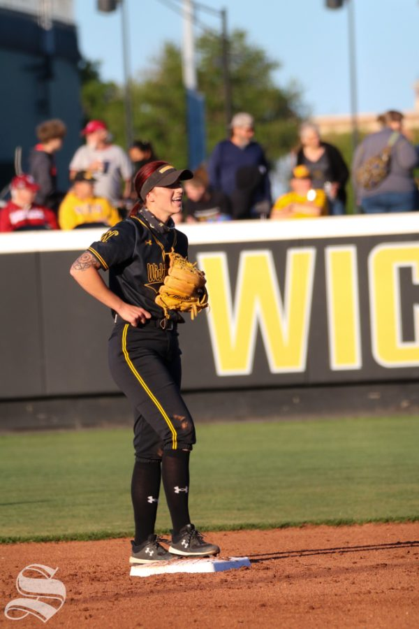 Wichita State sophomore, Sydney McKinney shares a smile with fellow teammate during a game against University of Oklahoma at Wilkins Stadium on April 4