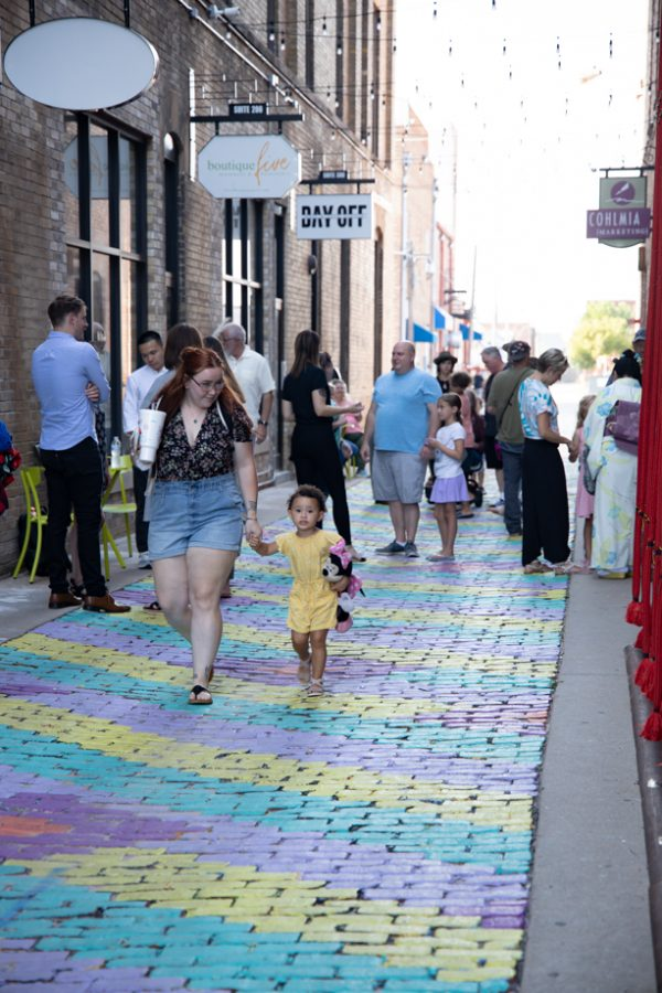 People enjoing art at Gallery Alley on July 2, 2021.
