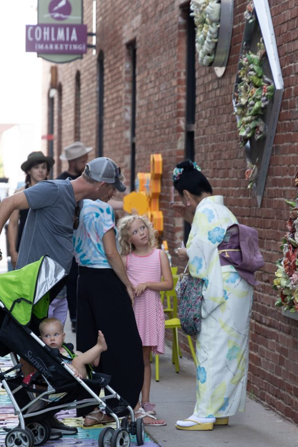 Artist Tomiyo Tajiri talks to visitors at the reopening of Gallery Alley on July 2, 2021. Tomiyo Tajiri created Maitreya.