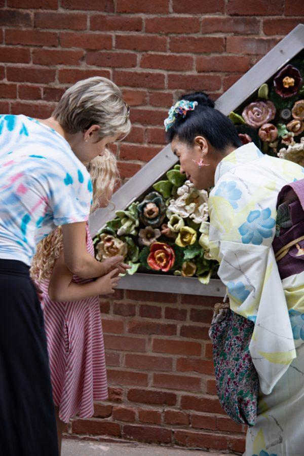 Artist Tomiyo Tajiri hands out origami at Gallery Alley on July 2, 2021. Tomiyo Tajiri created Maitreya.