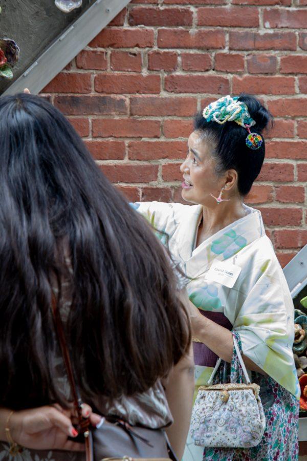 Artist Tomiyo Tajiri at the reopening of Gallery Alley on July 2, 2021. Tomiyo Tajiri created Maitreya.