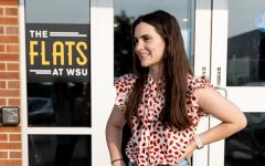 Wichita State student Alice Fitzgerald, president of The Green Group, talks about the new recycling bins to be placed in the Flats and the Suites at WSU on July 21, 2021.