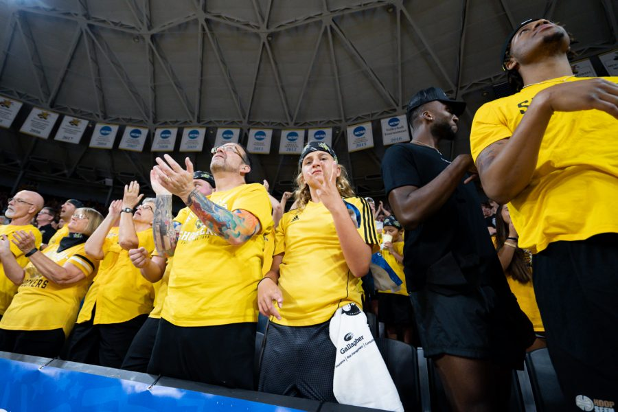 Ruven Funschelle celebrates a 3-pointers from Conner Frankamp during a TBT tournament game in Charles Koch Arena.
