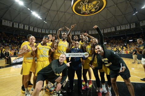 The Aftershocks celebrate following their victory over Team Challenge ALS on July 20 inside Charles Koch Arena.