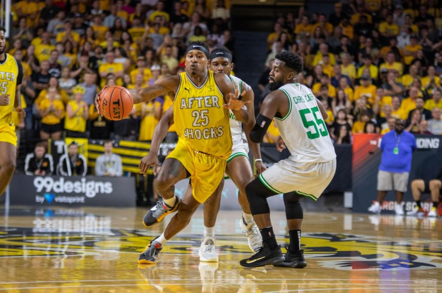 Aftershocks guard Tyrus McGee drives towards their basket in their game against Team Challenge ALS on July 20 inside Charles Koch Arena.