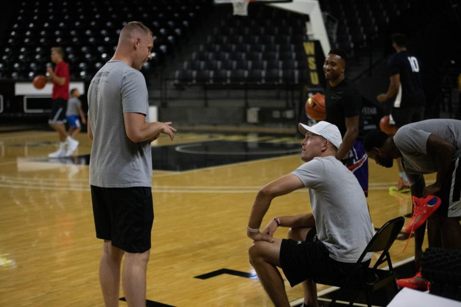 AfterShocks head coach Zach Bush and general manager Ron Baker talk during their first practice on July 13 inside Charles Koch Arena.