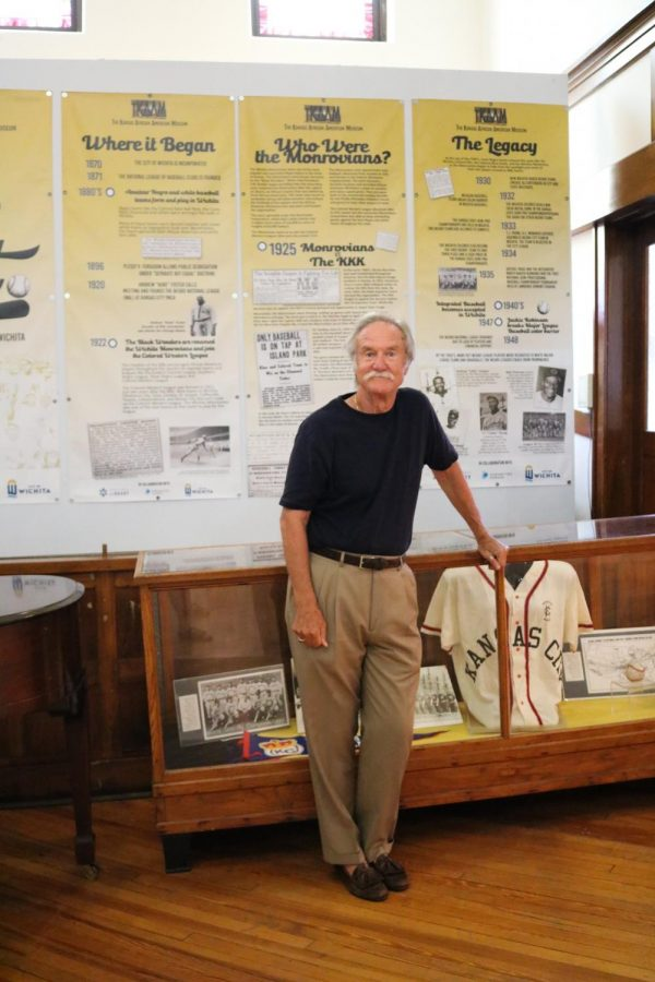 Ted Ayres stands by his favorite baseball history exhibit at the African American Museum on July 27.