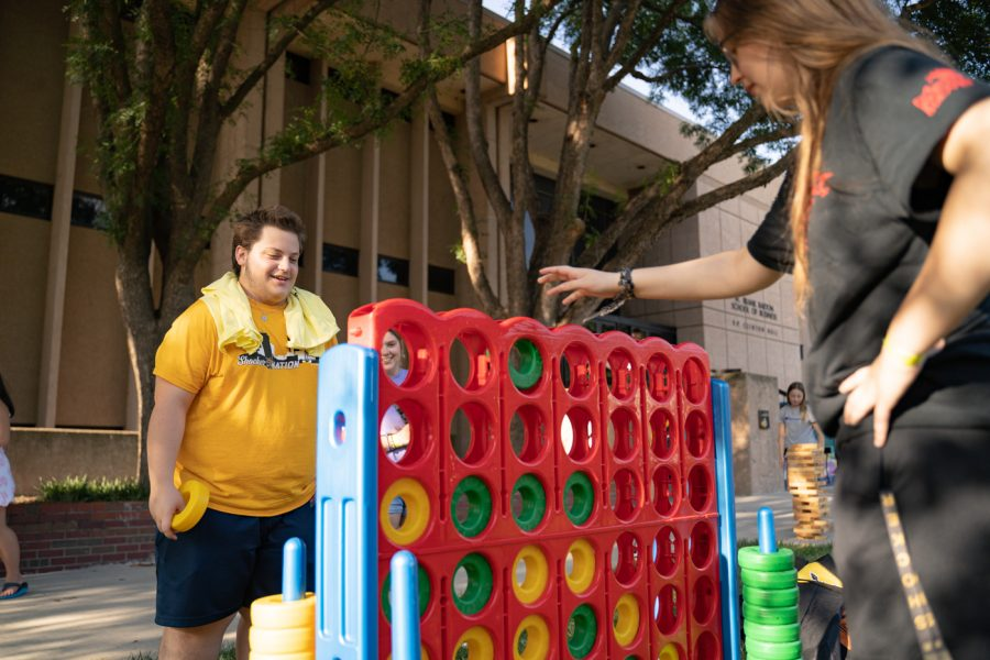 Freshman Douglas Zilch plays tic tac toe during the Back to School Bash. The event was hosted by Student Involvement on Aug 14 in the RSC Courtyard.