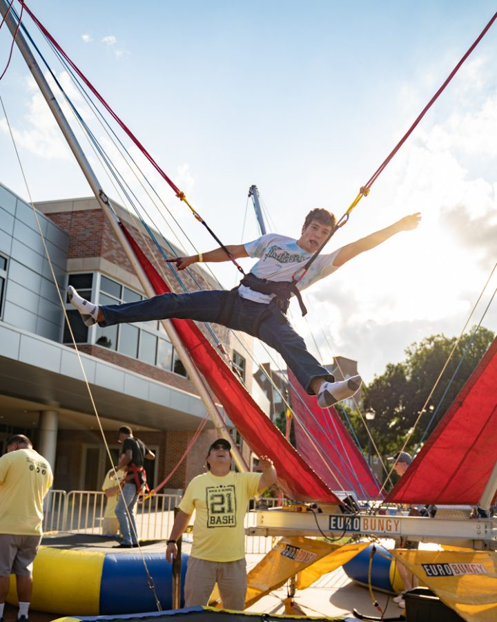 Freshman Evan Wickoren poses mid air during during the Back to School Bash. The event was hosted by Student Involvement on Aug 14 in the RSC Courtyard.