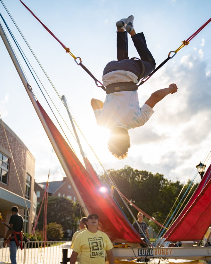 Freshman Evan Wickoren flips in the air during the Back to School Bash. The event was hosted by Student Involvement on Aug 14 in the RSC Courtyard.