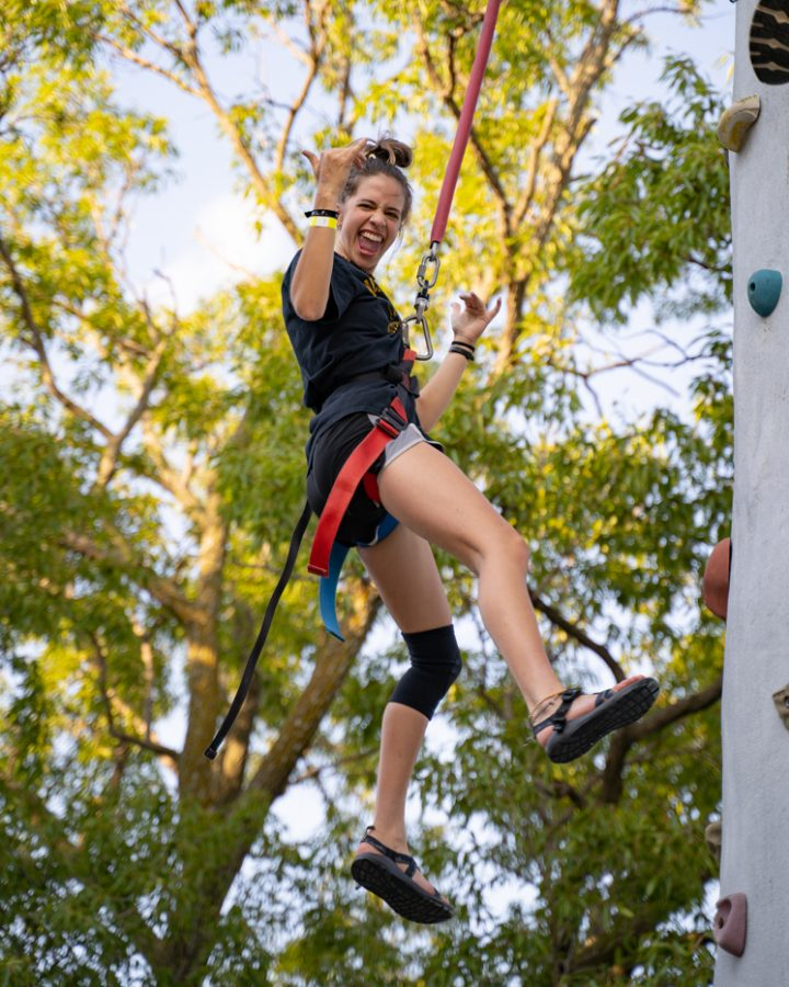 Freshman Erin Jacobson does wall climbing during the Back to School Bash. The event was hosted by Student Involvement on Aug 14 in the RSC Courtyard.