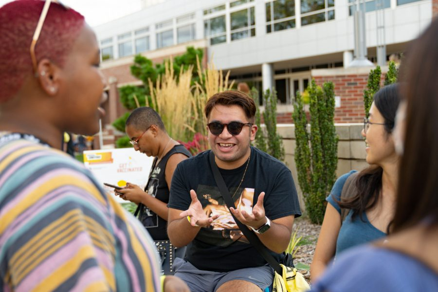 Senior Ivan Castillo talks to his friends during the Back to School Bash. The event was hosted by Student Involvement on Aug 14 in the RSC Courtyard.