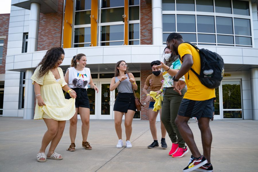 Students show off their dance moves during the Back to School Bash event on Aug 14 in the RSC Courtyard.