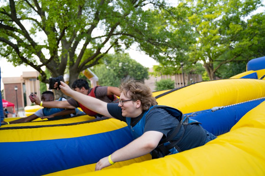 A student participates in one of many games at the Back to School Bash. The event was hosted by Student Involvement on Aug 14 in the RSC Courtyard.