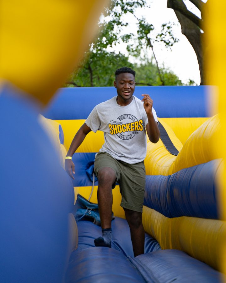Freshman Desmond Robinson plays a game during the Back to School Bash on Aug 14 in the RSC Courtyard.