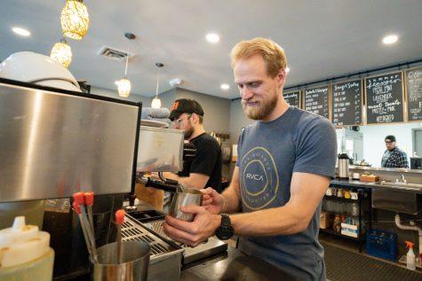 Lucas Lash makes coffee at Fairmount Coffee Company on Aug. 17.