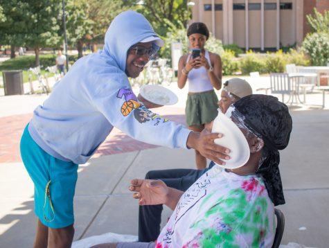 Wichita State students pies two of the Black Student Union during their Pie a cabinet member event on Aug. 23.