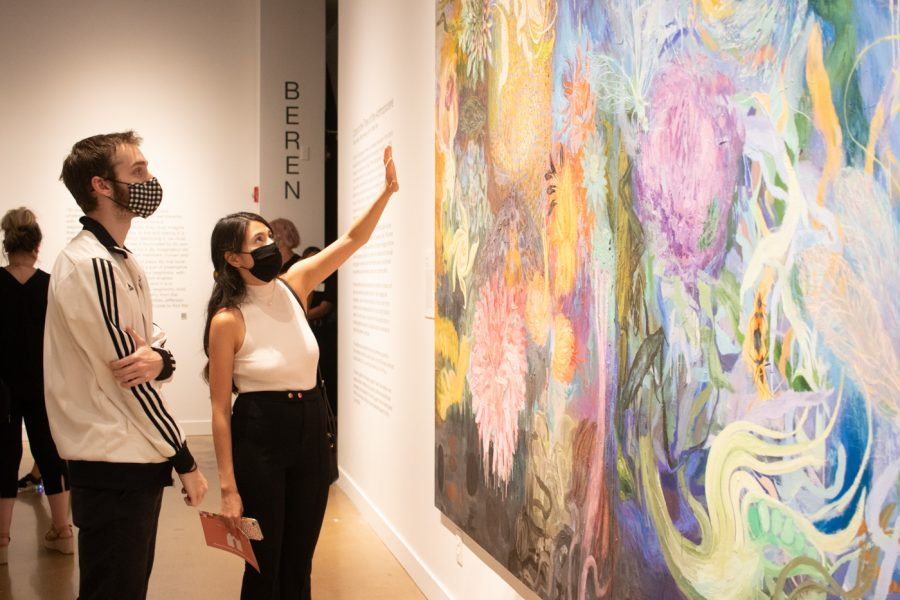 Guests view the complex mural of A. Mary Kay at the Ulrichs fall exhibit opening Aug. 26.
