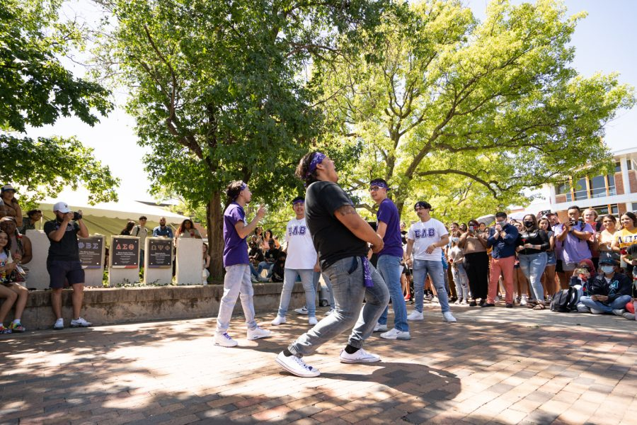 Members of Sigma Lambda Beta fraternity stroll during the Yard Show on Aug 24.