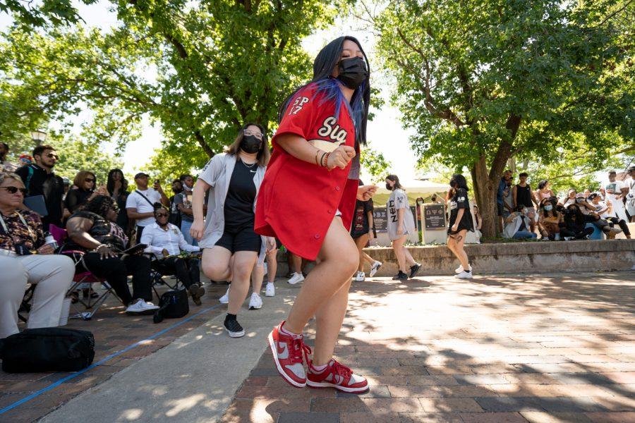 Truc Nguyen of Sigma Psi Zeta sorority strolls during yard show on Aug 24.