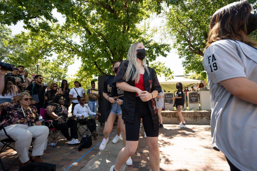 Hanna Hoopes of Sigma Psi Zeta sorority strolls during yard show on Aug 24.