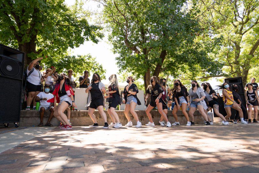 Members of Sigma Psi Zeta sorority stroll during yard show on Aug 24.