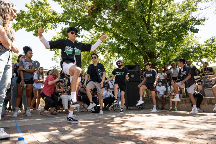 Members of Chi Sigma Tau fraternity stroll during yard show on Aug 24.