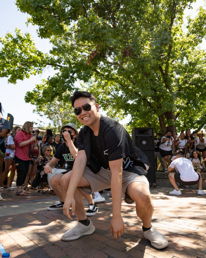 A member of Chi Sigma Tau fraternity stroll during yard show on Aug 24.