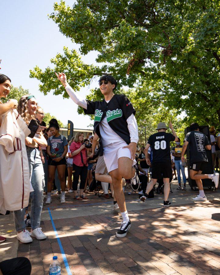 Brian Le of Chi Sigma Tau fraternity strolls during yard show on Aug 24.