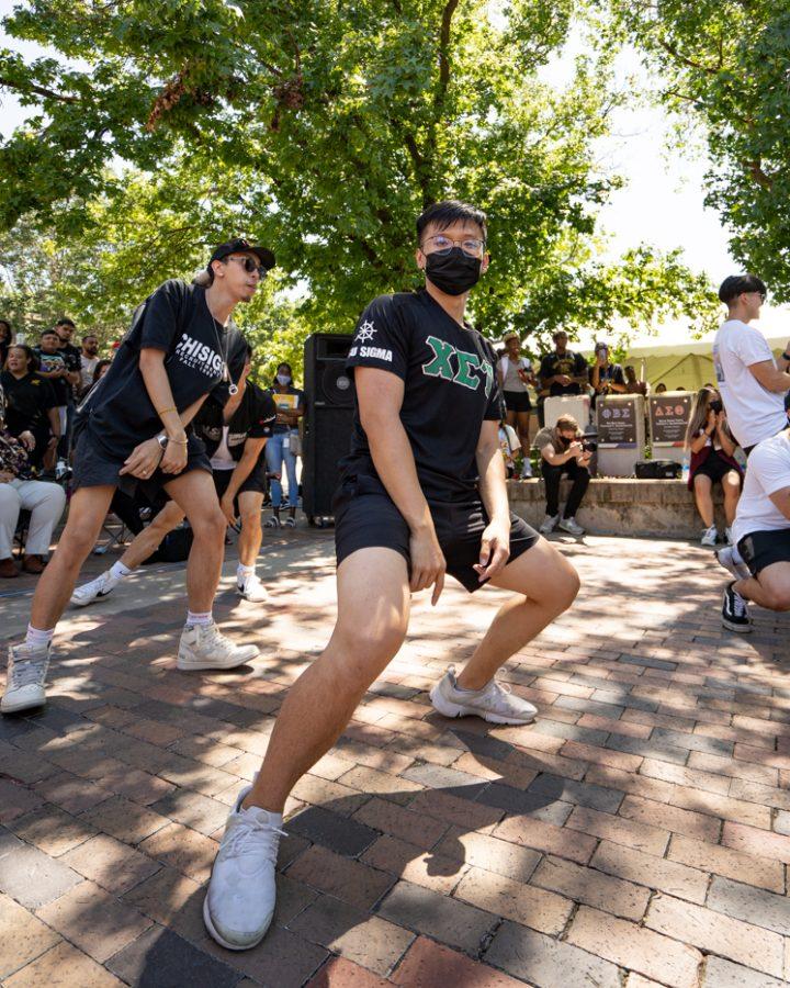 Theo Ha of Chi Sigma Tau fraternity strolls during yard show on Aug 24.